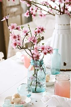cherry blossoms in mason jar - not huge on the whole mason jar thing but the blue and pink are pretty