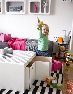 toy storage coffee table- easily hide toys in the living room