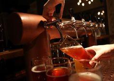187774436-bartender-at-hops-barley-brewpub-pours-a-pint-of-beer