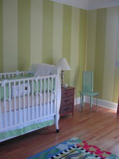 Stripes on one wall in nursery - two shades of green