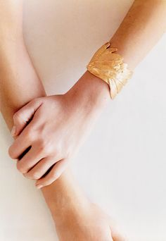 I am so touched by this bracelet. There is something so special and angelic about it.  Gold and angel wings. Enough said.