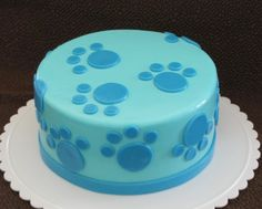 Blues Clues Cake Really easy paw prints by using different sized circle fondant cutters.