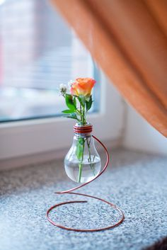 Vintage vase from Recycled Soviet Light Bulb on a stand of copper wire This vase can be easily transformed into many interesting things that