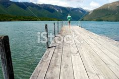 Man on Lake Rotoiti Jetty, Nelson Lakes National Park Royalty Free Stock Photo Image Now, Lakes, Surfboard, Waterfall, National Parks, Royalty Free Stock Photos, Landscape, Photography, Scenery