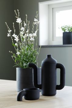 The vessels you put plants and hand picked flowers in make all the difference. This is a striking example.