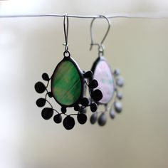 Floral earrings made ​​of iridescent deep green stained glass, tin without lead and patinated copper. Spring nature inspired jewelry add a new unique accent to your style! #artkvarta #spring #green #floral #earrings #floraljewelry #iridescent #handmade #stainedglass #springfashion #greenaccessories