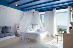 Love the whimsical aspect of this room, the accents of blue, the softly romantic design and, of course, the view!