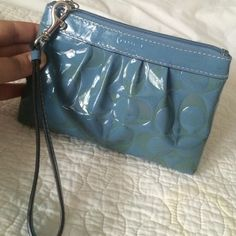 Coach clutch Authentic. In good condition. Front and bottom has some staining. No rips or scuffs. Inside clean with small pocket. Coach Bags Clutches & Wristlets