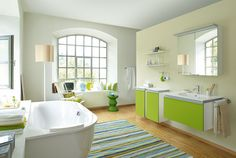 Fresh shades of mint and lime green in minimalist bathroom