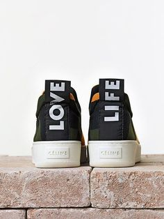 """The Love Life sneaker -Céline's Spring Summer 2014 slip-on sneakers with the motto """"love"""" and """"life"""" up the back of the shoe."""