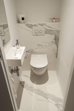 Cloakroom toilet - A light, bright colour scheme is perfect for creating the illusion of space in a small bathroom or cloakroom Opt for white and grey marble tiles to add light and give the room a stylish appearance Bad Inspiration, Bathroom Inspiration, Bathroom Ideas, Bathroom Storage, Bathroom Furniture, Furniture Storage, Bathroom Remodeling, Cloakroom Ideas, Restroom Ideas