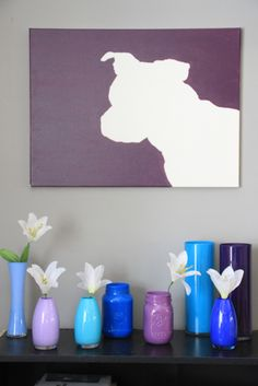 I so want this boxer shadow canvas but in different color (and minus those vases). So cute!
