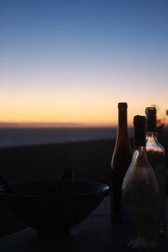 sunrise? or sunset? if the bottles are empty… sunrise, i think.
