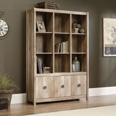 Features:  -Hidden storage behind doors.  -Made in the USA.  -Color: Brown.  -Material: Manufactured wood.  Product Type: -Cube unit.  Style: -Traditional/Rustic.  Finish: -Lintel oak.  Frame Material