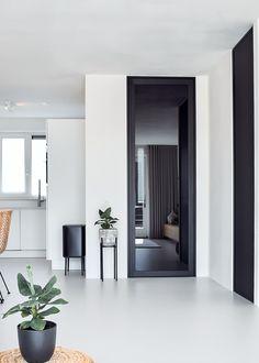 Zwarte glazen deur in 'steel look' uitvoering via onze lokale verdeler Muller Wonen - By ANYWAYdoors