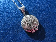 Aromatherapy locket on silver plated chain. $18.95, via Etsy. (but no Do Terra oil, which is an illegal copy of Young Living.)