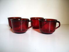 Add a pop of color to any tea and conversation setting with these vintage ruby red cups. They are a set of red glass tea or coffee cups in beautiful condition. all are signed Arcoroc France. They are in great vintage condition with no chips, cracks or scratches. A festive way to jazz up the holiday table or use to add color to the table.  Measure:  3 1/2 across X 2 1/2 tall  Thanks for peeking
