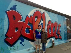 Mike Hay representing the Vodafone Warriors in front of the Berlin Wall