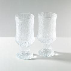 Ultima Thule Clear Glass: Finnish designer and sculptor Tapio Wirkkala's modern water glasses are inspired by the melting ice in Lapland (hence their beautiful rippled texture). | Unison