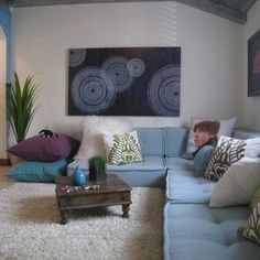 Like the idea of big floor cushions for seating in kids play area.