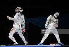 Cecilia Berder (R) of France and Chen Shen (L) of China compete during women's Sabre Individual Fencing semi-final match on he second day of 2015 World Fencing Championships in Moscow, Russia, on July 14, 2015.