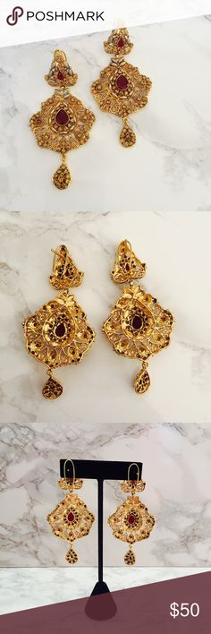 """Chandelier gold earrings Indian vintage Maroon Absolutely beautiful gold colored earrings! Maroon and silver accents. Indian vintage inspired. Perfect condition, never worn before. Perfect for special occasions. Great Christmas gift for your girlfriend, sister, mother grandmother OR yourself  These look great paired with a flattering black or maroon dress. Length: 3.25"""" ShezadiBazar Jewelry Earrings"""