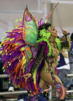 A reveller parades for the Mocidade Alegre samba school during the carnival in Sao Paulo.