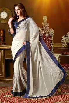 White chiffon saree with blue art silk blouse with price $85.95 .Embellished with embroidered and resham.Saree comes with v neck blouse.It is perfect for casual wear, festival wear, party wear and wedding wear.Andaaz Fashion is the most popular designer wear online ethnic shop brands.  http://www.andaazfashion.us/festival/diwali-collection/style/saree-diwali-collection