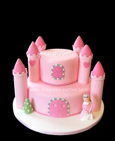 """Pink Castle Cake 11"""" round and 6"""" round moist chocolate cakes for a 1st birthday."""