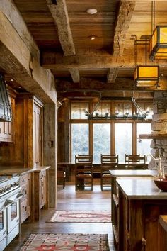 Rustic Kitchen with Mission Studio Prairie Mission Chandelier #607, Inset cabinets, Flat panel cabinets, Reclaimed wood