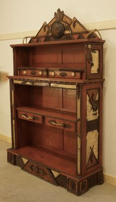 www.lpostrustics.com This Adirondack Rustic Native American inspired bookcase was created by our family.  It features birch bark and twig, pyrography, chip carving, antler sheds and painted and distressed cabinetry.