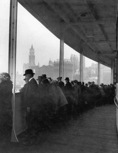 Passengers on a ferry plying the waters of the Hudson River travel past the Lower West Side of Manhattan. New York. 1914
