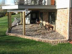 Under the deck landscaping- no more muddy doggie footprints on rainy days!