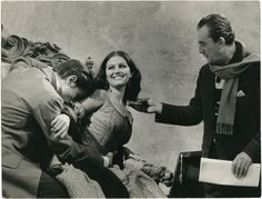 Alain Delon, Claudia Cardinale and Luchino Visconti on the set of Il gattopardo, 1963