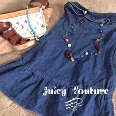 """HPJuicy Couture Denim Dress. Juicy Couture denim strapless dress. Ruffled skirt and ruffle detail around top. Measure 24"""" from top to bottom. Tie in the back. 100% cotton. Great condition.  No rips, holes or stains. Labeled as a 25P, fits like an XS. HOST PICK Weekend Wear 4/5/14 Juicy Couture Dresses Strapless"""