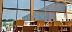 Charleston school library solar window shades allow for daylighting while controlling heat and glare. Window Coverings, Window Treatments, Automatic Shades, Window Roller Shades, Solar Screens, Blackout Shades, Cleaning Blinds, Solar Shades, Blinds For Windows