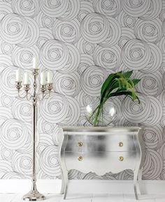 love both the wallpaper and foiled dresser