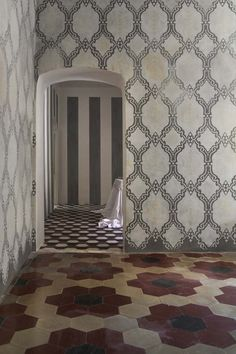 Absolutely fantastic mix of patterns of floors and walls.  Makes the somewhat ordinary architecture look special.
