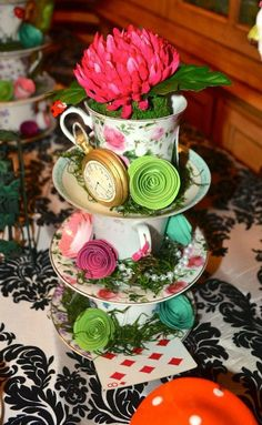 Mad hatter baby shower decor nice centre piece, but could make single cups look as good too