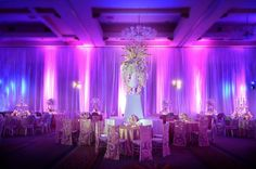 Glamorous Florida Wedding - MODwedding Do you like the lighting? It's a good way to make an otherwise plain ballroom look nice.