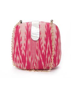 The Minaudier  This precious clutch is sealed with a real shell clasp.  Rebecca Minkoff Mini Minaudier in Coral/Cream Ikat, $250;