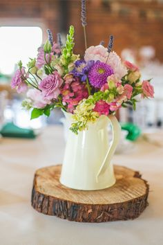 Bride to Be Reading ~ Jug vase centrepiece of bright flower bouquet. Emerald themed Sopley Mill Wedding in Dorset