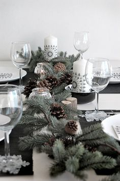 oh, heavens. #christmas table in white and silver, with greenery and pinecones.