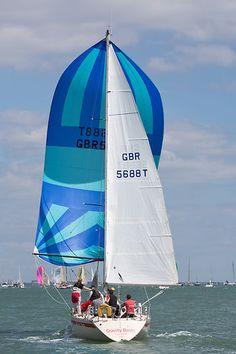 The Beneteau First 32 yacht 'Gravity Boots' racing during Cowes Week 2013.