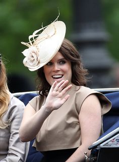 Princess Eugenie of York waves at the crowd during the annual Trooping The Colour ceremony at Horse Guards Parade on June 13, 2015 in London, England.