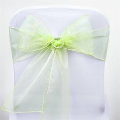Apple Green Organza Chair Sash | eFavorMart /  Beautiful and charming crystal organza chair sashes are a real treat to eyes and big attention grabbers. Add that sophisticated touch of chic elegance into your event's décor with our splendid sheer organza chair sashes. Made from premium quality nylon, these chair sashes will impart an impeccable sheen and glossy luster to your plain reception or wedding chairs and chair covers, creating that super WOW factor you so eagerly want to attain. Wrap…
