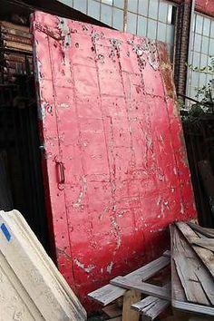 Huge red industrial metal rolling fire door