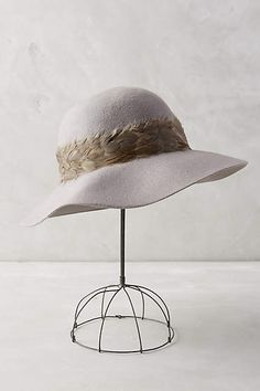 Anthropologie EU Plumage Floppy Hat. We are huge fans of versatile, timeless accessories, like this classic floppy hat with an elegant feather band. Cast in a delicate cloud grey, it's the perfect piece for any season.