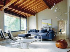 Living Room love the slanted wooden ceiling and wide open window