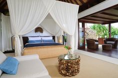 Villa Nora's bright and airy master bedroom is located at the cliff edge of the property and features a private seating area and plunge pool. Perfect for a romantic getaway! #semarauluwatu #bali